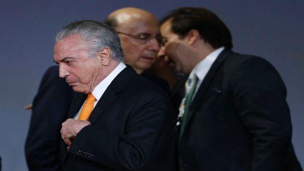el_presidente_de_brasilx_michel_temerx_abandona_el_escenario_durante_el_foro_de_inversixn_brasil_2017_en_sao_paulo_-_ap.jpg_1718483347
